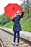 Woman with umbrella on railroad Stock Photography