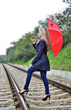 Woman with umbrella on railroad Royalty Free Stock Image