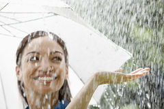Woman with umbrella in the rain Stock Image