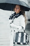 Fashion woman with umbrella in the rain on city street Royalty Free Stock Photography