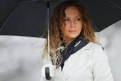 Fashion woman with umbrella in the rain Royalty Free Stock Photo