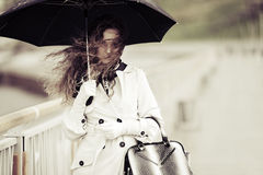 Woman with umbrella in the rain Royalty Free Stock Images