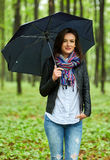 Woman with umbrella in the rain Stock Photo