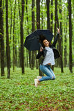 Woman with umbrella in the rain Stock Photos