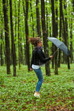 Woman with umbrella in the rain Royalty Free Stock Image