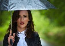 Woman with umbrella in the rain Stock Image