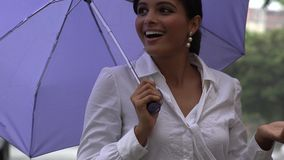 Woman with Umbrella in Rainy Weather stock video
