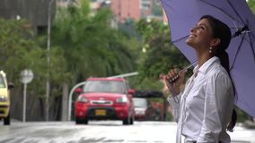 Woman with Umbrella in Rainy Weather stock video footage