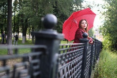 Woman with umbrella red on street Royalty Free Stock Photography