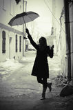 Woman with umbrella retro in old city Stock Photos