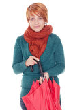 Woman with umbrella and scarf. Young woman with umbrella and scarf on a winter day Royalty Free Stock Image