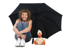 Woman with umbrella and toy Royalty Free Stock Photography