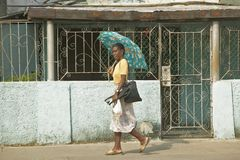 A woman with an umbrella walking down the street of Havana, Cuba Stock Images