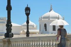 Woman with umbrella walking under the sun. Cadiz, Spain Royalty Free Stock Photography