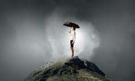 Woman with umbrella Stock Photo