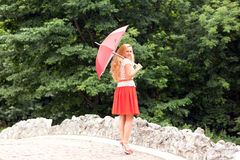 Woman with an umbrella Stock Photos