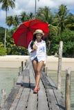 Woman with umbrella Stock Photos
