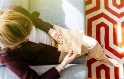 Woman unboxing unpacking Amazon.com box royalty free stock images