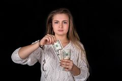 Woman with unchained handcuffs and dollar royalty free stock photo