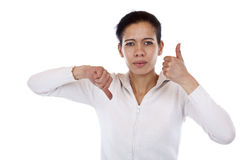 Woman is undecided and shows thumb up and down Stock Photo