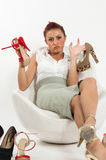 Woman undecided about which shoes to wear. Beautiful Italian woman undecided about which shoes to wear Stock Photography