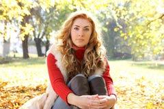 Woman under autumn golden trees Stock Photography