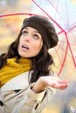 Woman under autumn rain stock image