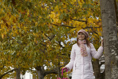 Woman under the autumn tres Stock Images