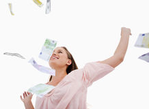 Woman under bank notes falling Royalty Free Stock Images