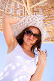Woman under beach umbrella Stock Photo