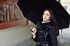 Woman under black umbrella Stock Photo