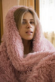 Woman under blanket Royalty Free Stock Photos