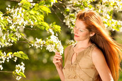 Woman under blossom tree in spring Royalty Free Stock Photos