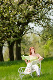 Woman under blossom tree in summer Stock Photo