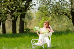 Woman under blossom tree in summer Stock Images