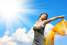 Woman under blue sky Stock Photography