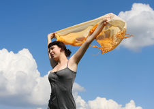 Woman under blue sky Royalty Free Stock Image