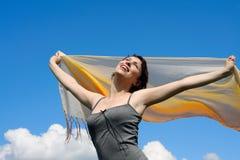 Woman under blue sky Stock Photos
