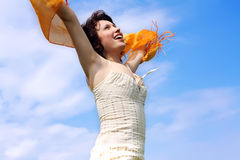 Woman under blue sky Royalty Free Stock Photography