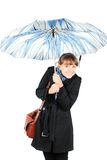 Woman under blue umbrella. Beautiful young woman in black coat with blue umbrella isolated on white background royalty free stock photo