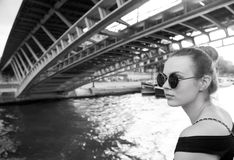 Woman under bridge in Paris, France Stock Photos