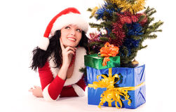 Woman under the Christmas tree with Christmas Royalty Free Stock Photo