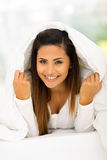 Woman under duvet Royalty Free Stock Images
