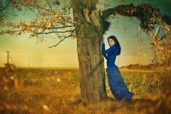 Woman under fallen tree Stock Images