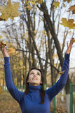 Woman Under Falling Leaves In Park Stock Photography