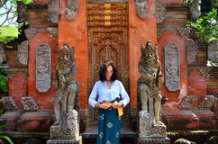 Woman under gate in Puru tirtha empul Temple. Indonesia royalty free stock images