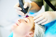 Woman under laser cosmetology procedure Royalty Free Stock Photo