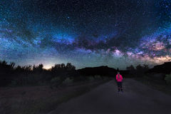 Woman under the Milky Way Stock Images