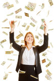 Woman under a money rain made of dollars Royalty Free Stock Images