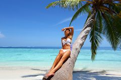 Woman under palm. Sea on backgroud Royalty Free Stock Photo